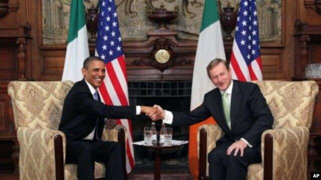 US President Barack Obama, left, and Taoiseach Enda Kenny shake hands during talks in Farmleigh, Dublin, May 23, 2011