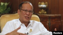 Philippine President Benigno Aquino gestures during an interview with Reuters at the Malacanang presidential palace in Manila, July 2, 2012.