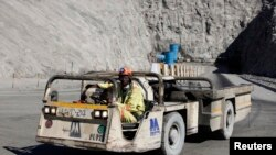 FILE - A worker drives a vehicle at Zimplats' Ngwarati Mine in Mhondoro-Ngezi May 30, 2014.