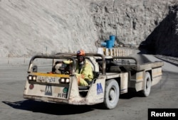 FILE - A worker drives a vehicle at Zimplats' Ngwarati Mine in Mhondoro-Ngezi May 30, 2014. Leaked documents allege Zimplats used an offshore company to pay management salaries without the knowledge of the Reserve Bank of Zimbabwe.