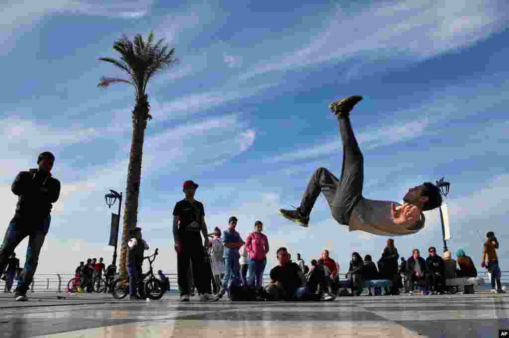 Syrian refugee Mohammed al-Shareef, who fled with his family from Damascus, performs a breakdance on the Mediterranean waterfront promenade in Beirut, Lebanon.