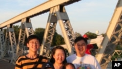 Evan Choi with parents and siblings standing on the suspension bridge in Waco, TX.