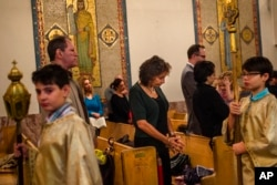 Members of the Arab-American community worship at St. Mary's Antiochian Orthodox Church in the Brooklyn borough of New York, Oct. 9, 2016.