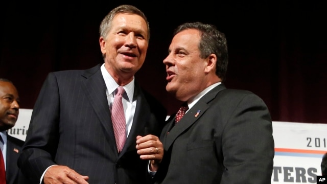 FILE - Republican presidential candidates, John Kasich and Chris Christie after an Aug. 3, 2015 forum in Manchester, N.H.