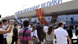FILE - Visitors arrive at Alexander the Great Airport, near Macedonia's capital, Skopje, Sept 6, 2011.