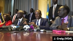 FILE - South Sudan's First Vice President Taban Deng Gai, center, speaks to reporters in Nairobi, Kenya, Aug. 17, 2016.