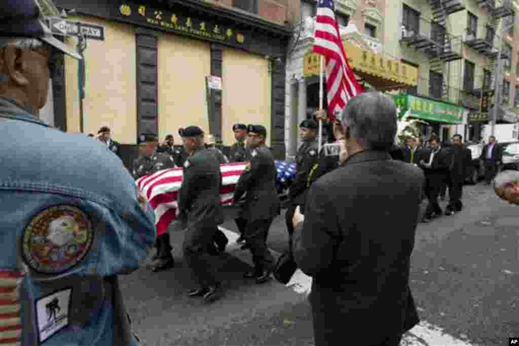 Private Danny Chen's casket is carried by soldiers during his funeral procession on Thursday, Oct. 13, 2011 in New York. Chen was killed on Oct. 3 in a noncombat-related death in Kandahar province in Afghanistan. (AP Photo/Jin Lee)
