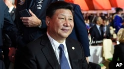 FILE - China's President Xi Jinping attends the opening session at the COP21, United Nations Climate Change Conference, in Le Bourget, outside Paris, Nov. 30, 2015..