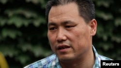 FILE - Chinese human rights lawyer Pu Zhiqiang talks to reporters in Beijing, July 20, 2012.