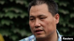 FILE - Chinese human rights lawyer Pu Zhiqiang faces trial Monday for allegedly using social media to incite hatred and violence. He's shown in Beijing, July 20, 2012.