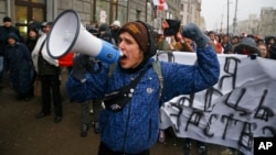 Belarusians shout slogans during a rally in support of sole traders in the city center in Minsk, Belarus, Feb. 28, 2016.