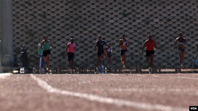 Sprinters during practice for the Olympics in Swaziland, July 2012 (Emilie Iob/VOA)