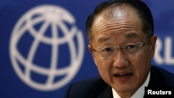 FILE - World Bank President Jim Yong Kim is seen speaking at a news conference.