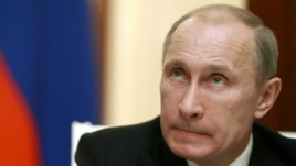 Russia's President Vladimir Putin looks on during a news conference at the Kremlin in Moscow, November 8, 2012.