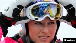 FILE - Overall leader of Alpine Skiing World Cup, Lindsey Vonn of the U.S. takes off her mask at the finish area of the Rosa Khutor Alpine skiing, in Krasnaya Polyana near Sochi, Feb. 19, 2012.