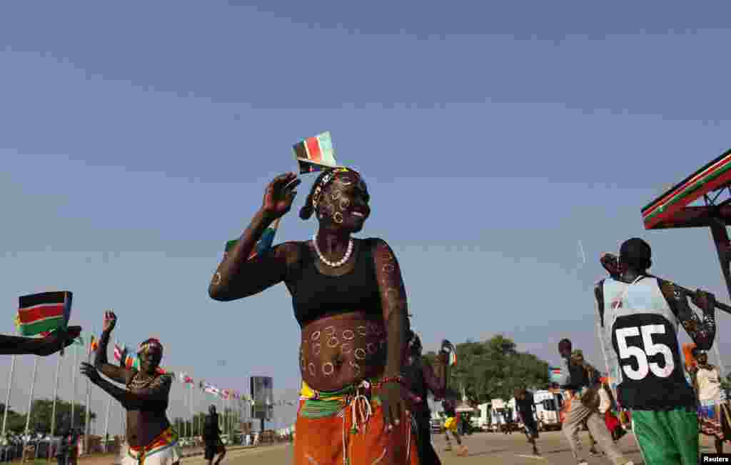A traditional dancer takes part in celebrations marking the third anniversary of South Sudan's independence, in Juba, July 9, 2014.