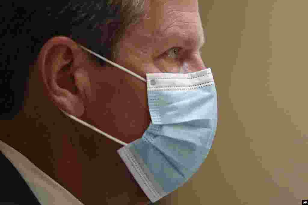 Georgia Gov. Brian Kemp looks on during a coronavirus briefing at the Capitol Friday, July 17, 2020, in Atlanta. (AP Photo/John Bazemore)