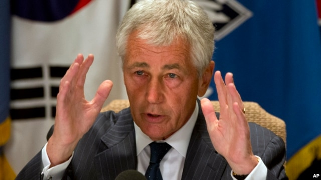 U.S. Secretary of Defense Chuck Hagel speaks to the traveling press about the U.S. government shutdown, at his hotel in Seoul, South Korea, Oct. 1, 2013.