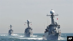 South Korean Navy Patrol Combat Corvettes stage an anti-submarine exercise at off the western coast town of Taean, 27 May 2010