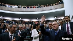 Turkish President Recep Tayyip Erdogan greets members of parliament from his ruling AK Party during a meeting in Ankara, April 24, 2018.