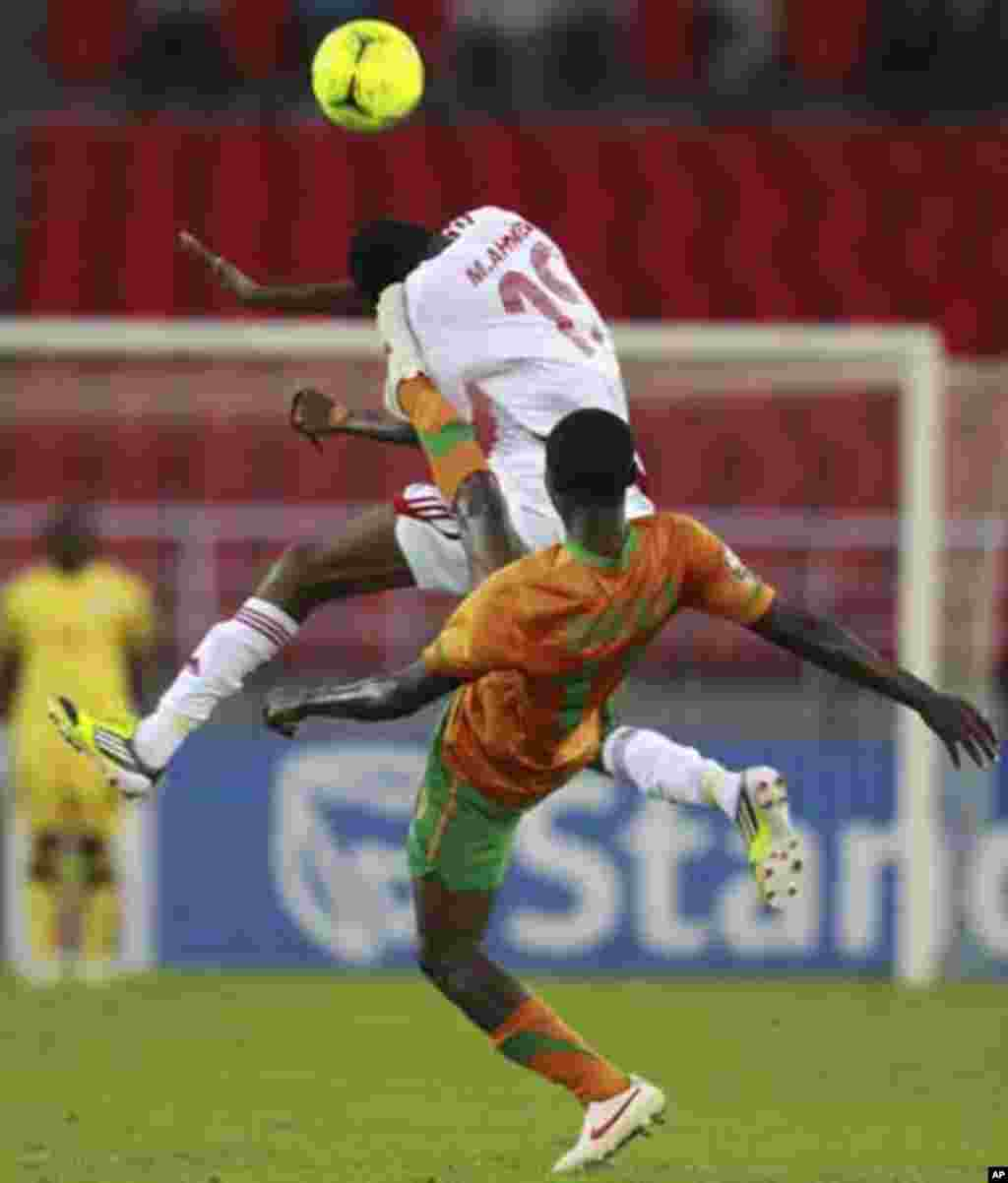 "Nathan Sinkala of Zambia (R) fights for the ball with Mohamed Ahmed of Sudan during their African Nations Cup quarter-final soccer match at Estadio de Bata ""Bata Stadium"", in Bata February 4, 2012."