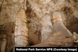 The Giant Dome is considered a column as it meets up with the ceiling. The nearly identical Twin Domes come up just short and are stalagmites.
