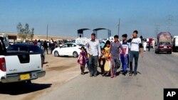 People leave their hometown Ramadi, 70 miles (115 kilometers) west of Baghdad, Iraq, April 15, 2015.