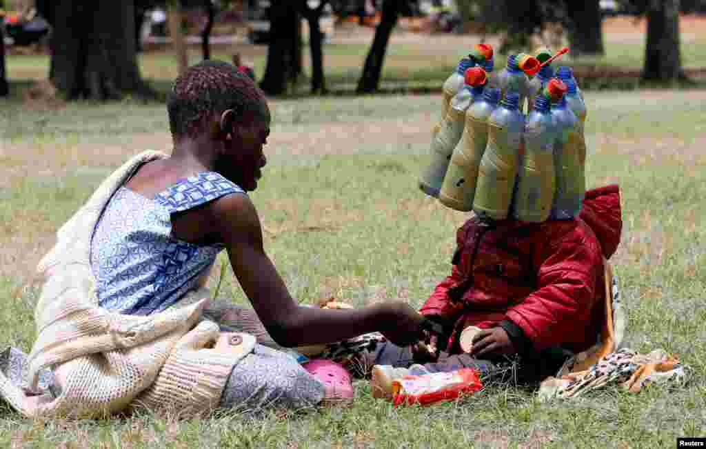 A child wears plastic bottle waste provided by climate change and environmental activists as they protest marking a global climate action day under the theme ''#AfricaIsNotADumpster'' at the Uhuru Park's Freedom Corner in Nairobi, Kenya.