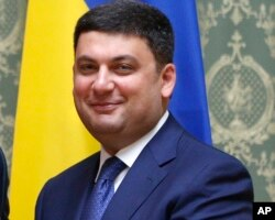 FILE - Ukraine's Prime Minister Volodymyr Groysman may struggle to get unpalatable pension reforms requested by the IMF through parliament, which include ending early retirement privileges for teachers and doctors.