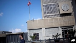 FILE - A pedestrian passes the U.S Embassy in Tel Aviv, Israel, Aug. 4, 2013. President-elect Donald Trump has said he would like to move the embassy to Jerusalem.