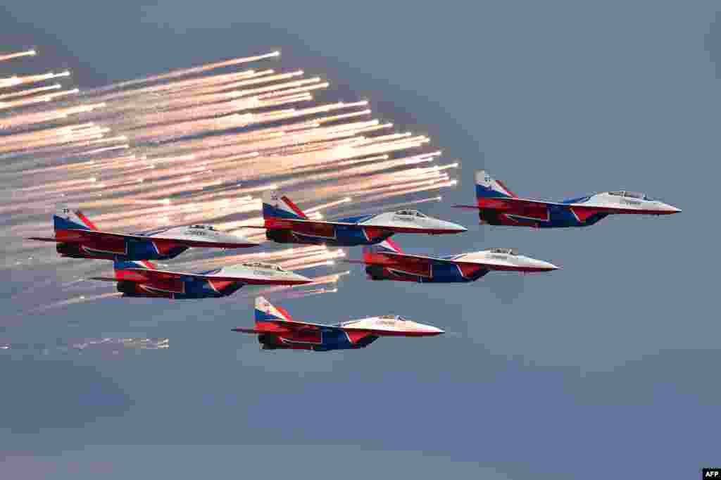 Russian aerobatic team Strizhi (Swifts) performs before the start of the Formula One Russian Grand Prix at the Sochi Autodrom circuit in Sochi.