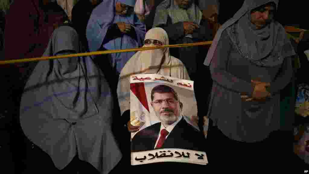 Supporters of Egypt's ousted President Mohamed Morsi chant slogans against Egyptian Defense Minister Gen. Abdel-Fattah el-Sissi in Nasr City, July 28, 2013.