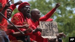 Members of the Economic Freedom Fighters protest outside the Constitutional Court in Johannesburg, Tuesday, Feb. 9, 2016.