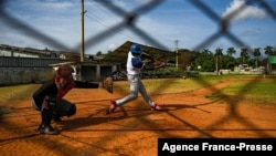 Baseball players play with friends at a field in Havana, Oct. 7, 2021. This year a record number of Cuban baseball players have defected abroad.