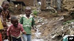 Children play near a punctured water pipe in Nairobi's Kibera slums (File Photo)