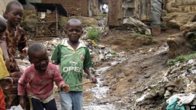 Children play near a punctured water pipe in Nairobi's Kibera slums (File Photo)
