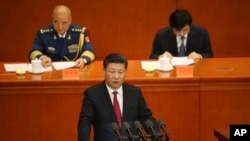Chinese President Xi Jinping, bottom, delivers his speech during a ceremony to mark the 95th anniversary of the founding of the Communist Party of China at the Great Hall of the People in Beijing, Friday, July 1, 2016.