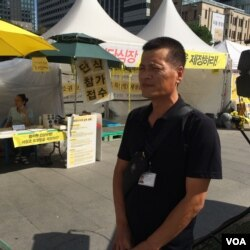 Lee Jeong-chul lost his teenage son when the South Korean ferry the Sewol sank in April. (Photo: Jason Strother for VOA)
