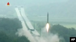 In this undated image made from video distributed on Tuesday, Sept. 6, 2016, by North Korean broadcaster KRT, a missile is launched during a drill at an undisclosed location in North Korea.