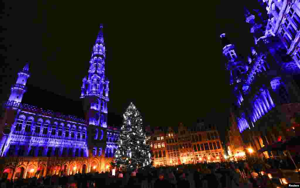 "Brussels' Grand Place is illuminated during a light show as part as ""Winter Wonders"" festivities, including a Christmas market and other events in central Brussels, Belgium, following tight security measures linked to the fatal attacks in Paris."