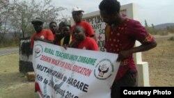 FILE: Rural Teachers Union of Zimbabwe executive members marching from Mutawatawa to Harare.