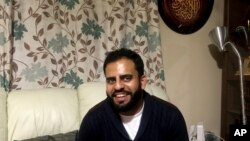 In this Nov. 21, 2017 photo, Irishman Ibrahim Halawa, who was recently acquitted after four years of imprisonment in Egypt, poses for a photograph at his home, in Dublin, Ireland. Halawa says he saw dozens of cellmates radicalize and adopt views of the so-called Islamic State during his brutal captivity in overcrowded jails.