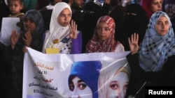 """Supporters of ousted Egyptian President Mohamed Morsi rally against the military and interior ministry, as they show the """"Rabaa"""" gesture, a sign to condemn police killing of hundreds of protesters."""