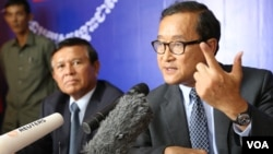 """At the Rescue Party's headquarters in Phnom Penh on Friday, party president Sam Rainsy told reporters that """"justice"""" for voters must first be found."""