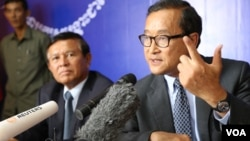 Opposition leader Sam Rainsy, right, said Tuesday that political negotiations with the ruling party have hit an impasse.
