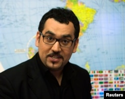 FILE - Press TV Newsroom Director Hamid Reza Emadi speaks with a correspondent during an exclusive interview with Reuters in Tehran, Jan. 21, 2012.
