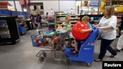 FILE - A family shops at a Wal-Mart Supercenter store in Springdale, Arkansas, June 4, 2015.