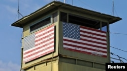 A U.S. Marine guard tower overlooks the Northeast gate leading into Cuba territory at Guantanamo Bay U.S. Naval Base, March 2013.