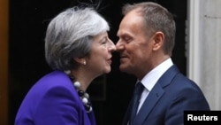 Britain's Prime Minister Theresa May greets European Council President Donald Tusk outside 10 Downing Street in London, March 1, 2018.