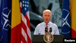 U.S. Vice President Joe Biden addresses Romanian and U.S. soldiers at Otopeni military airbase near Bucharest May 20, 2014.